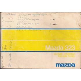 Mazda 323 Instructieboekje   Benzine Fabrikant 76 met gebruikssporen notities op kaft  Nederlands/Frans